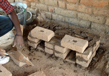 The Changu Changu Moto cookstove being constructed