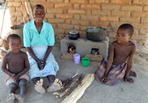AFTER: Mrs Longwe now has her Changu Changu Moto fuel-efficient cookstove