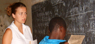 Alie, a volunteer teacher, teaching maths at Mwaya Primary School