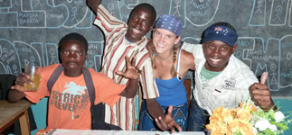 Happy students at a Form 4 graduation party with Chaz, a RIPPLE Africa volunteer