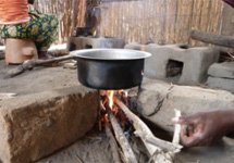 The Changu Changu Moto fuel-efficient cookstove saves wood, cooks faster, produces less smoke, and is much safer than the traditional three-stone fire