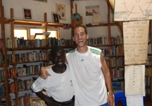Patrick with Barton, one of the library assistants