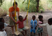 Giving one of the pre-school learners a go on the new swing