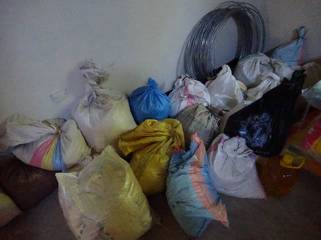 Storeroom filled with sacks of maize flour