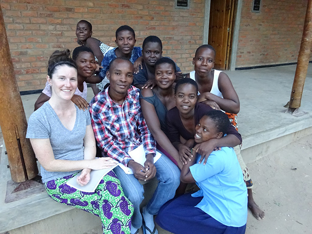 Bright and volunteer Alyson working with some of the other girls living at the dormitory