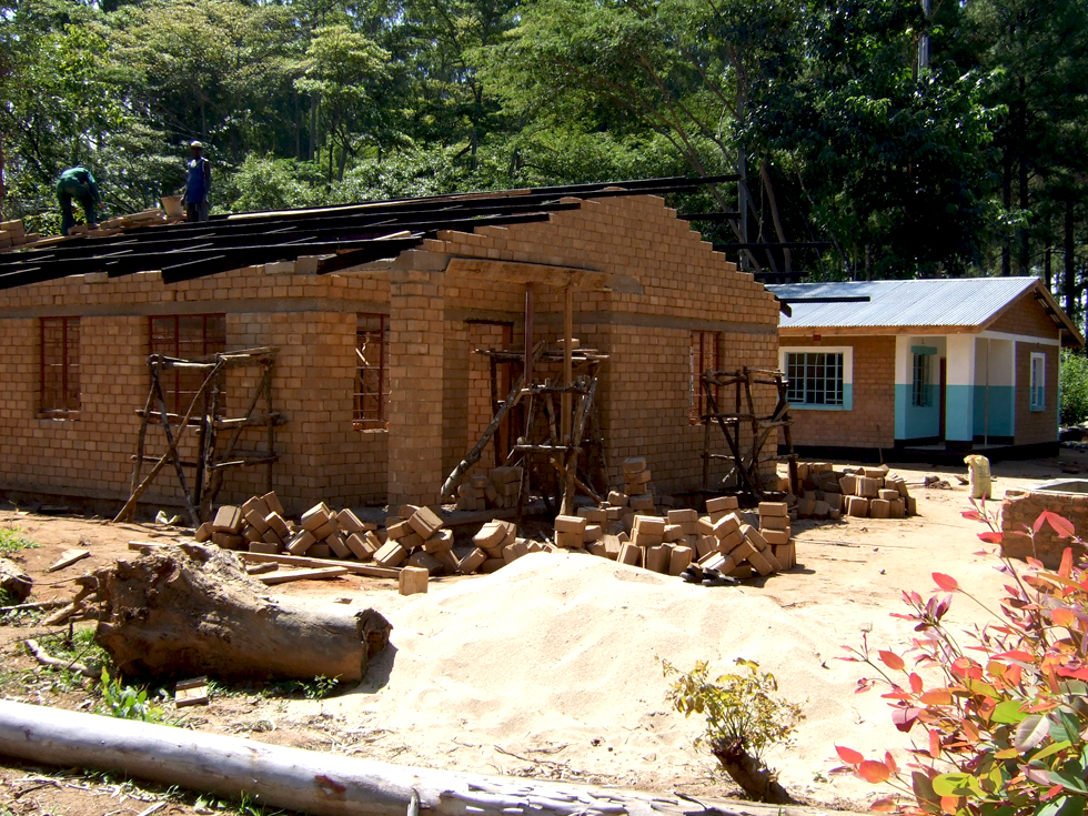 Teachers' houses under construction at Kapanda Secondary School. Houses are needed to attract and retain good teachers