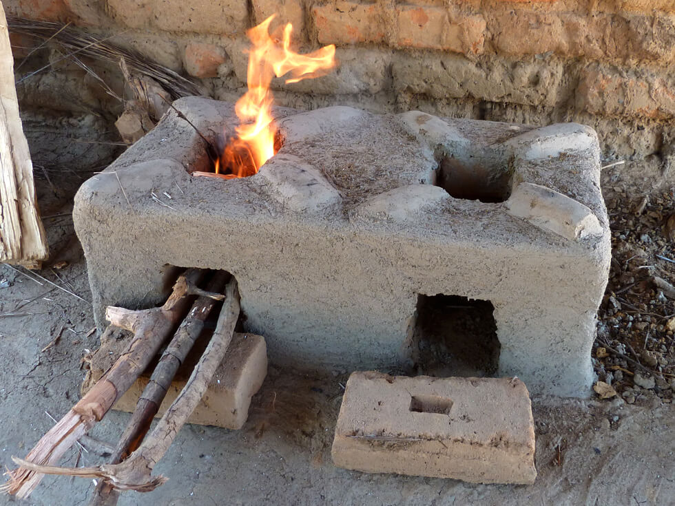 Two or three small pieces of wood are used at a time, and the bricks retain the heat to prolong cooking