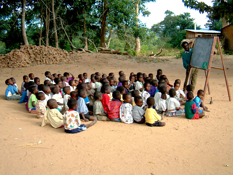 In some primary schools, lessons have to be taught outside due to a lack of classrooms