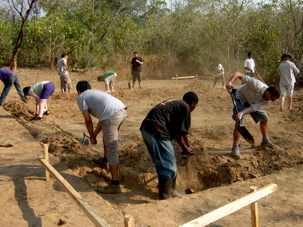 Aldenham School students digging the foundations for the Mwaya Community Dispensary