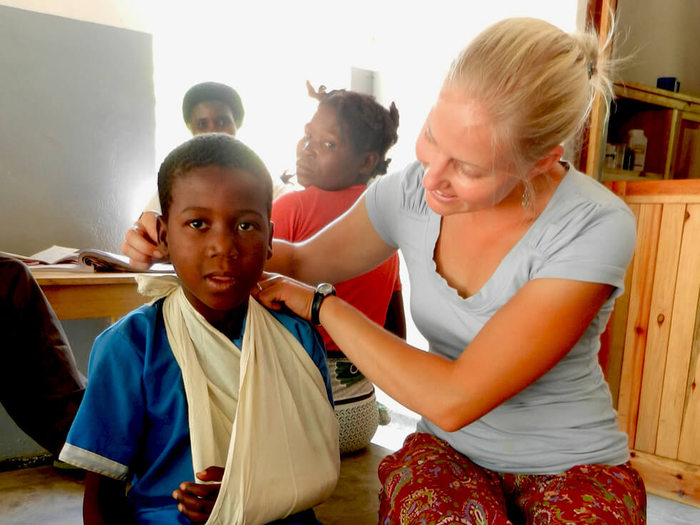 Nikki, a volunteer physiotherapist, working at Mwaya Dispensary
