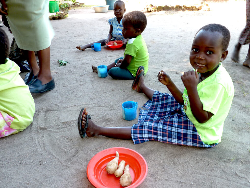 Many of the children are orphans, and the sweet potatoes provide essential nourishment