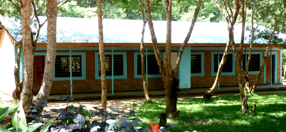 There are now four classrooms, teachers' offices, toilets, and several teachers' houses