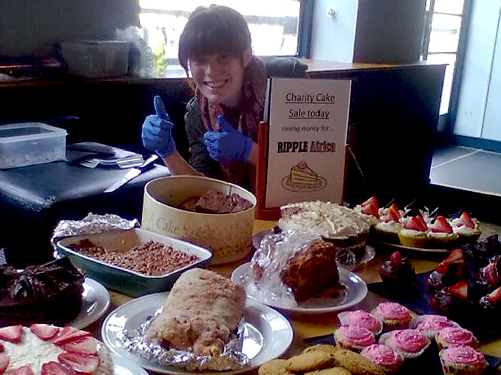 Emily selling homemade cakes — one of many fundraising events for RIPPLE Africa