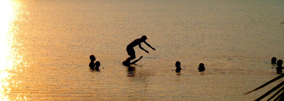 Volunteers making the most of the wonderful swimming at Mwaya Beach