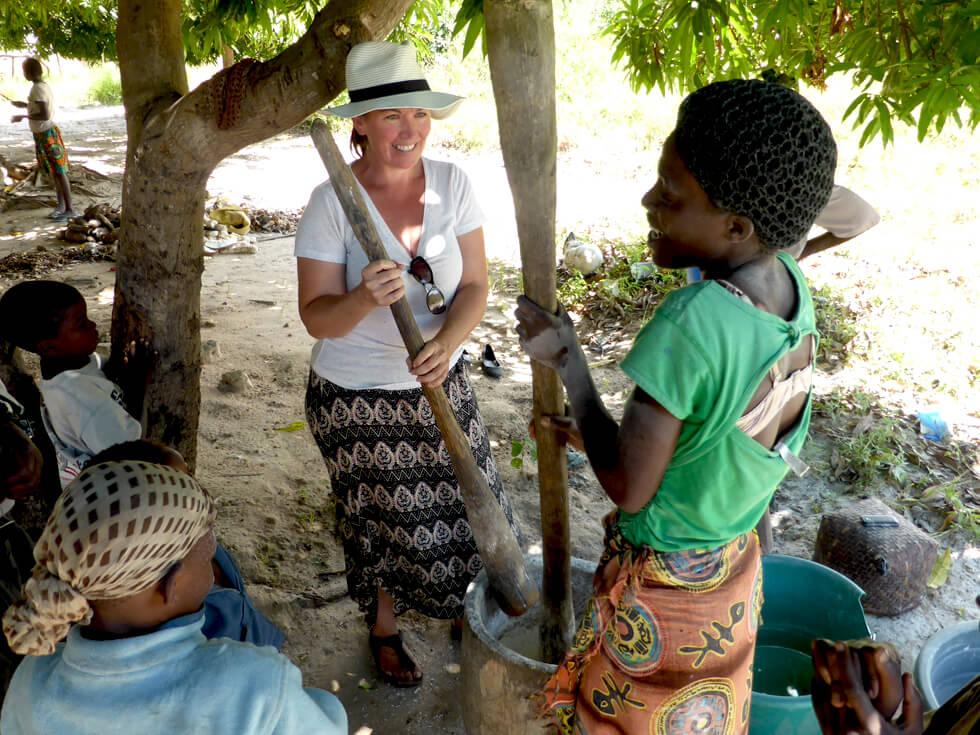 Pounding cassava in the local village