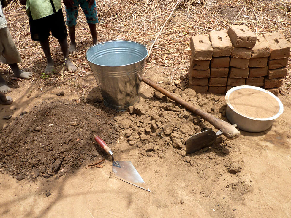 2. Collect clay soil and sandy soil, and possibly animal manure, to make the mortar