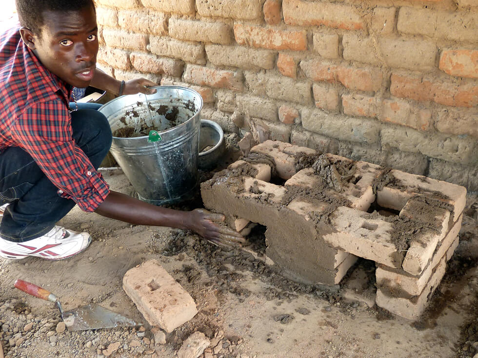 4. Once the cookstove is built, mud is plastered around the exterior