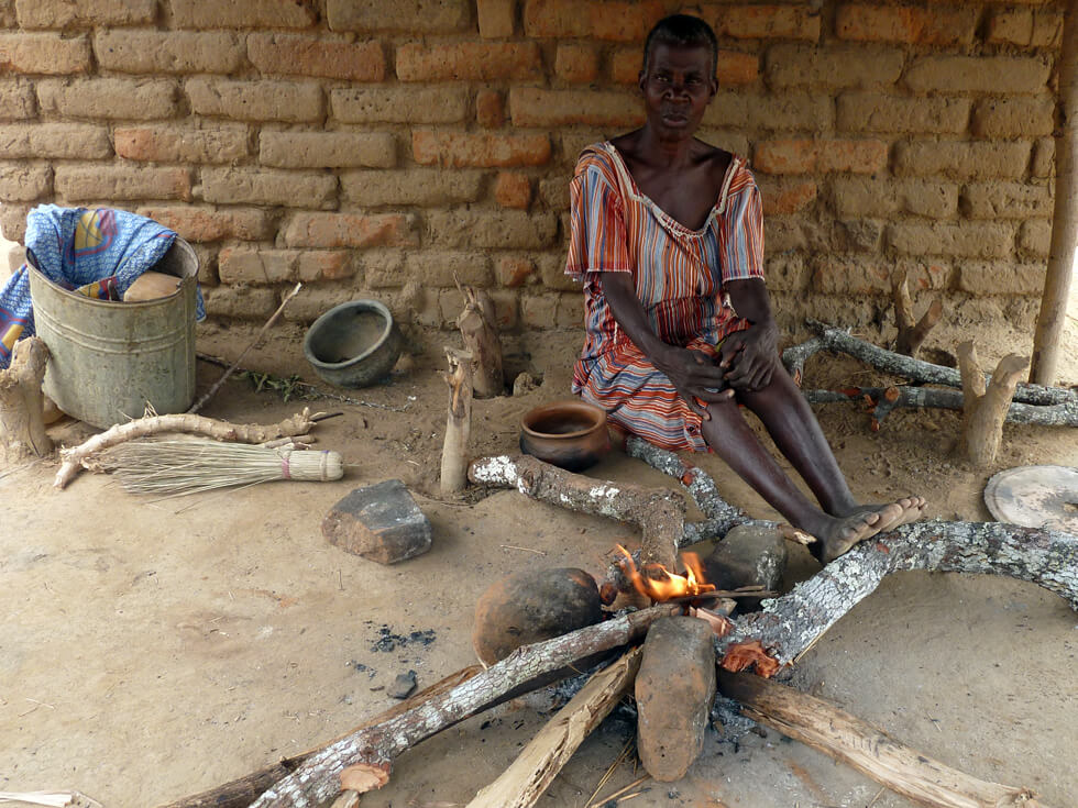 BEFORE: Mrs Longwe's three-stone fire