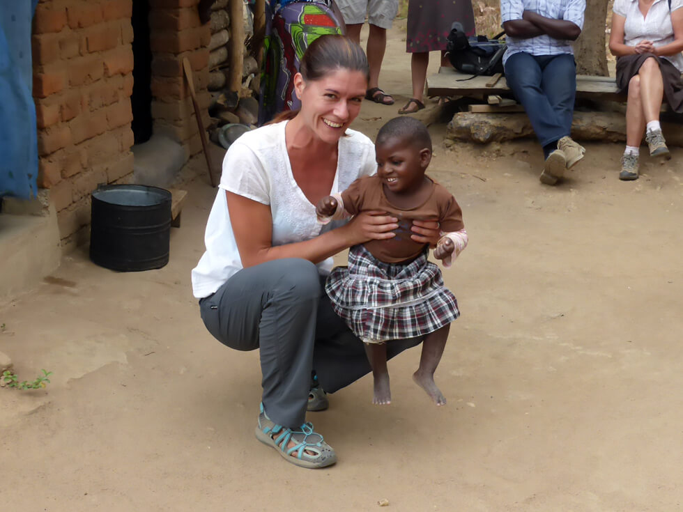Linda, a volunteer physiotherapist, working with a young patient