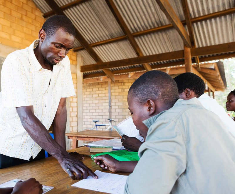 Burton leads an adult literacy class in Malawi Africa