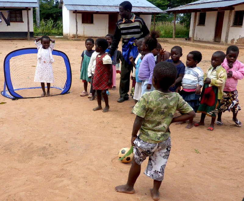 Children playing football malawi africa