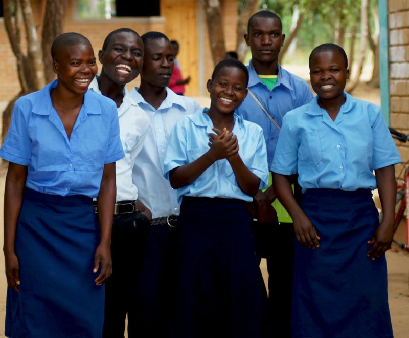 Secondary students group together for a photograph in Malawi