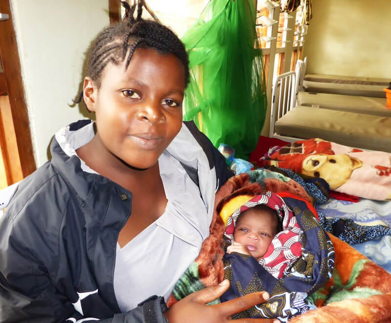 A new mother waits to be discharged from hospital in Africa
