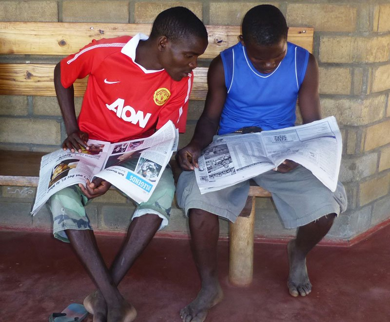 The community library provides newspapers for locals to read in Malawi