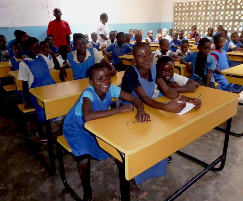 Pupils sit at school desks in a primary school in Africa