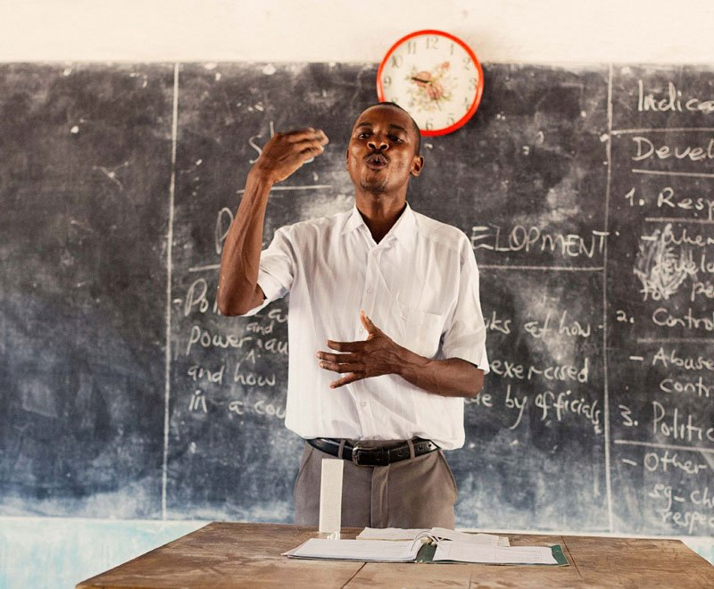 A teacher in Malawi addresses his class