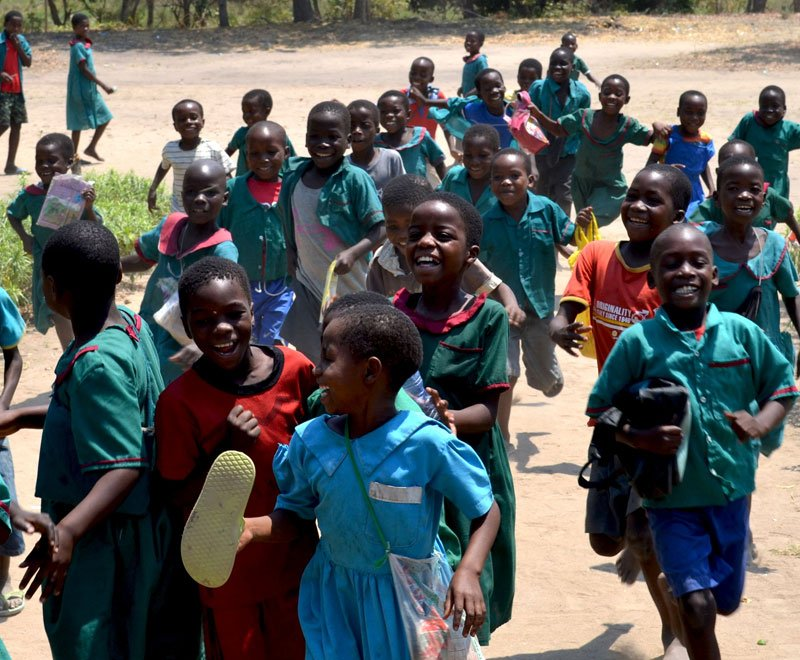 Children running to class at a primary school in Africa