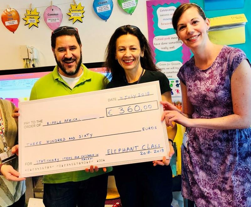 A cheque being presented after a school fundraising event