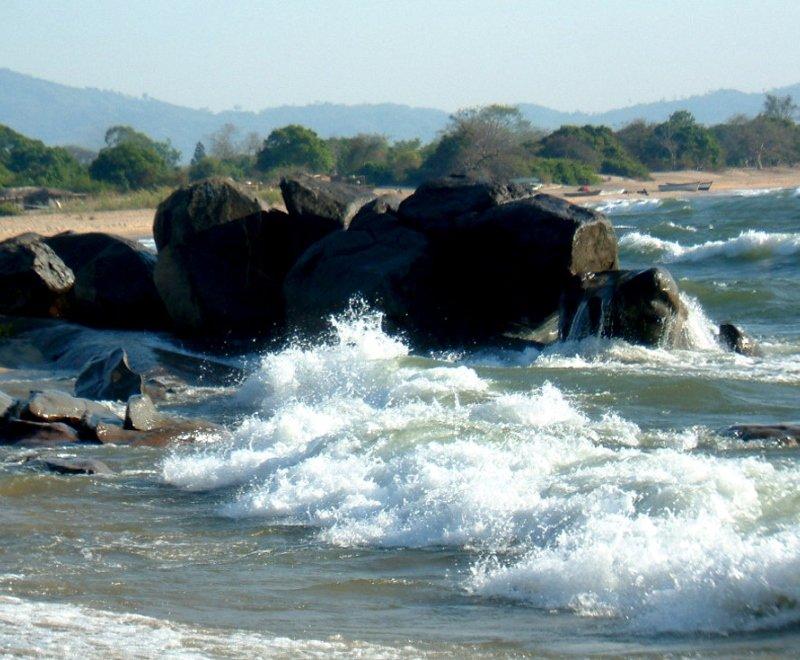 Waves crash on to rocks in Lake Malawi