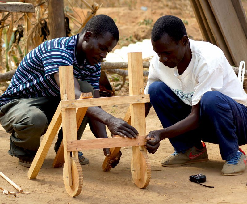Carpenters in Malawi make a bespoke disability device for a child