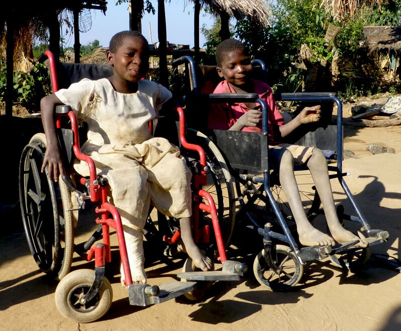 These Malawian siblings have received wheelchairs as they cannot walk due to having polio