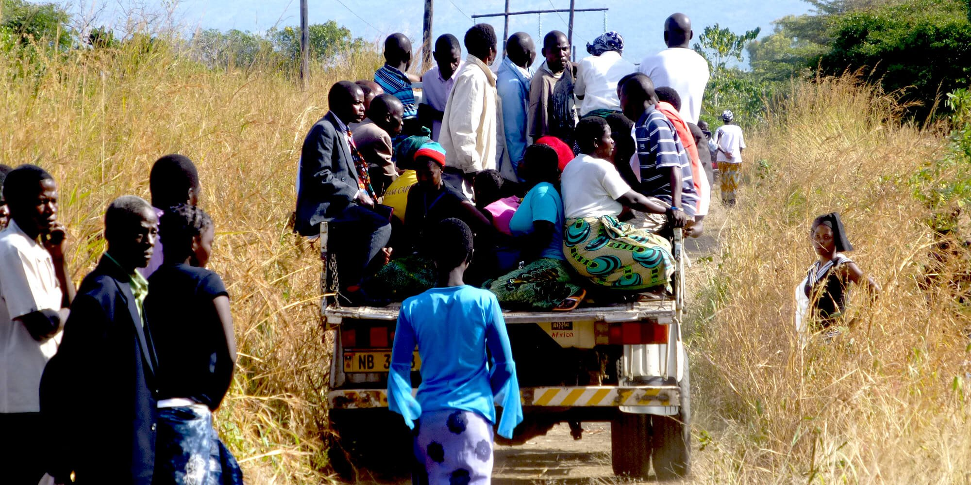 An overloaded lorry transports people in Malawi