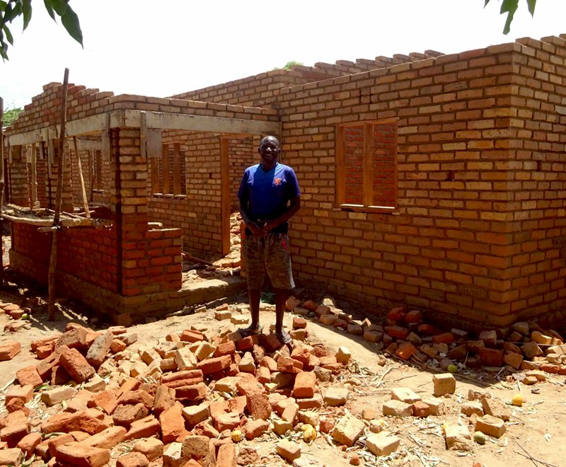 By empowering this fisherman he has been able to build this brick house in Africa
