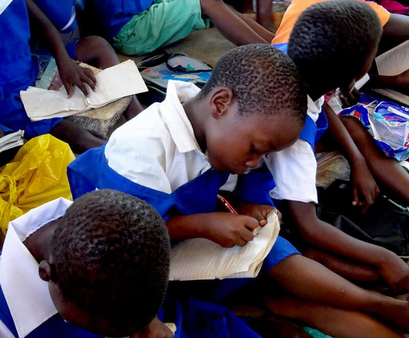 Child learning at a primary school in Africa