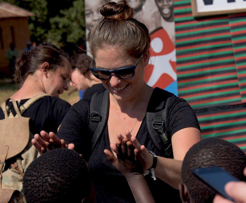 Volunteer in Africa spending time with children