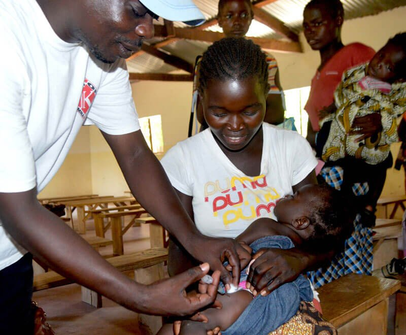 A child receiving a vaccination in Africa