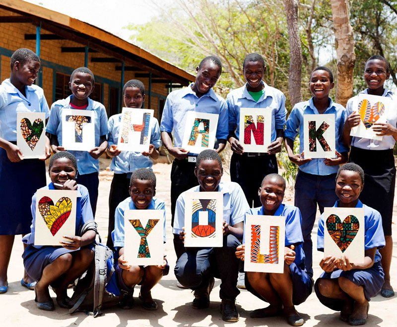 A group of secondary students say thank you from Africa
