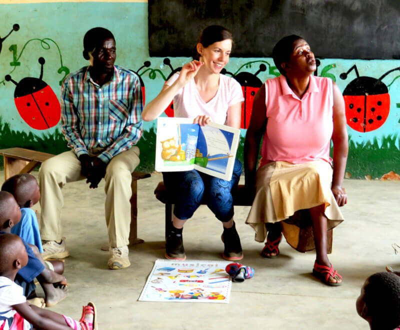 Teacher Emma reads at a pre-school in Malawi