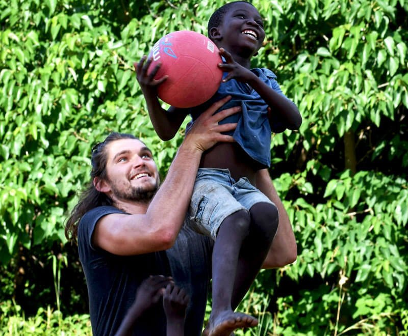 Kade plays netball in Malawi at primary school.