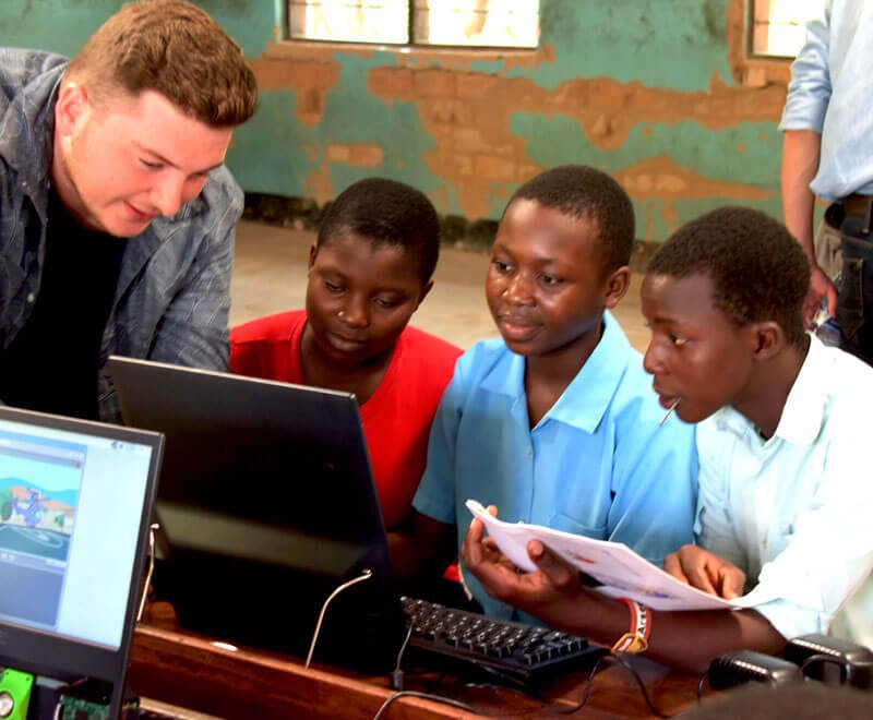 A small group of secondary school pupils learn computers