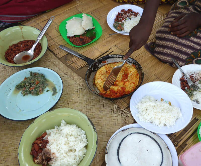 A typical local meal served with eggs rice beans and relish in Africa