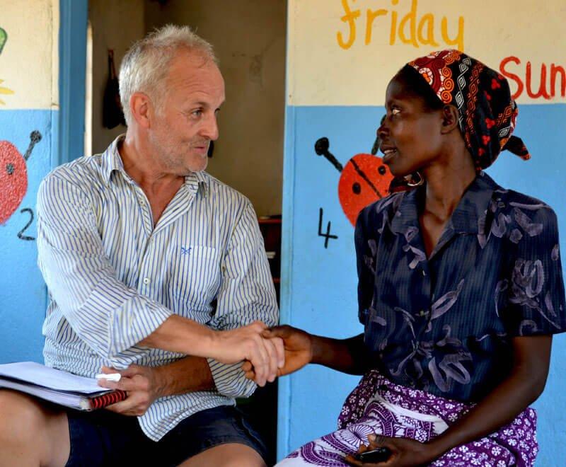 A volunteer talks with one of our preschool teachers in Malawi