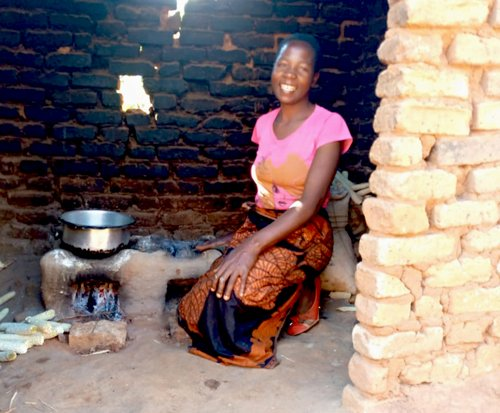 Chimwemwe with her fuel efficient cookstove in rural Malawi