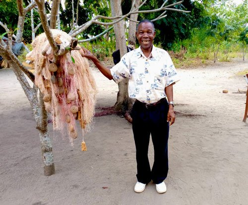 Fisherman in Malawi stands with his fishing nets