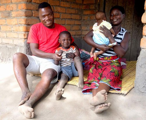 A family in Malawi learning about women empowerment and family planning