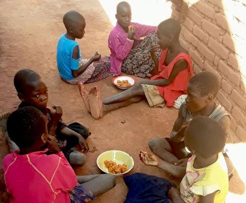 Children enjoy a breakfast of sweet potato in Malawi